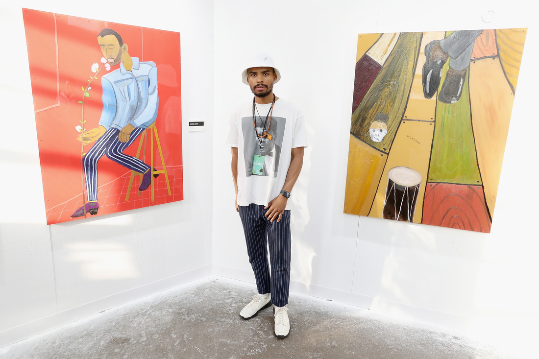 "Marcus Jahmal with his paintings at ""No Commision."" Photo © BFA, Angela Pham."