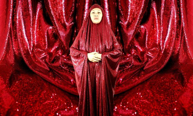 The Red Chador, A Performance Project by Anida Yoeu Ali. Photo courtesy of Pu Sem & 4A Centre for Contemporary Asian Art