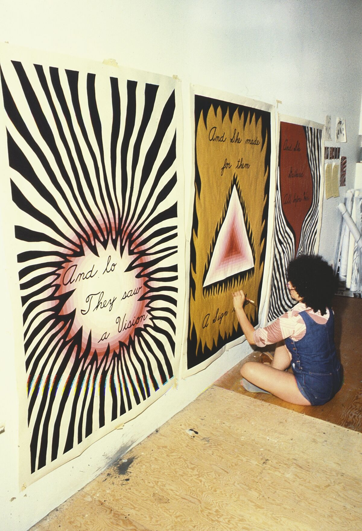 "Judy Chicago Designing the Entry Banners for ""The Dinner Party,"" 1978. Courtesy of Through the Flower Archive"