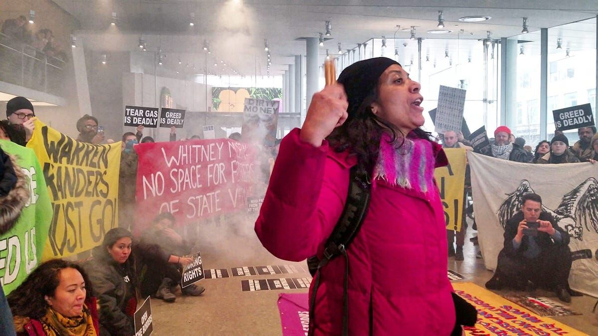 Members of Decolonize This Place and its supporters rallied in the lobby of the Whitney Museum of American Art on December 9, 2018. Photo courtesy Decolonize This Place.