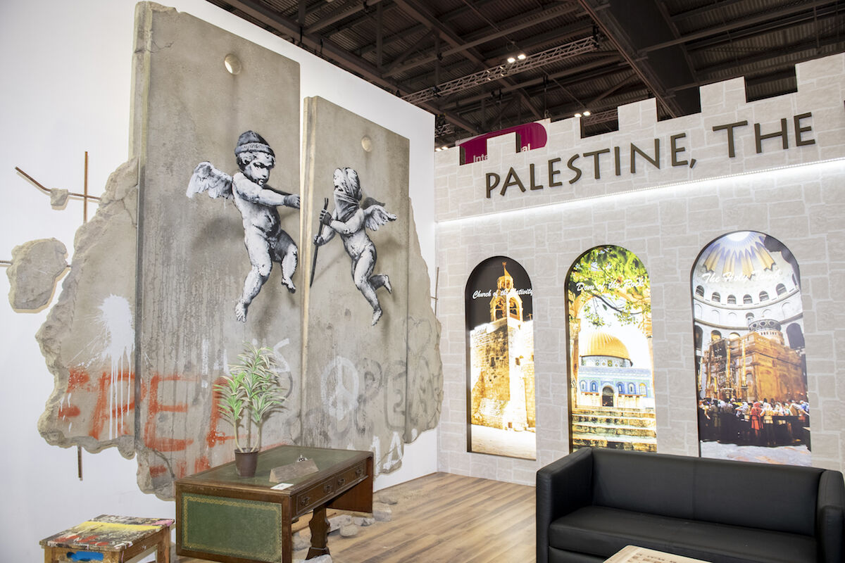 A new work by Banksy on view in the Palestine stand at the World Travel Market fair in London. Photo courtesy World Travel Market.