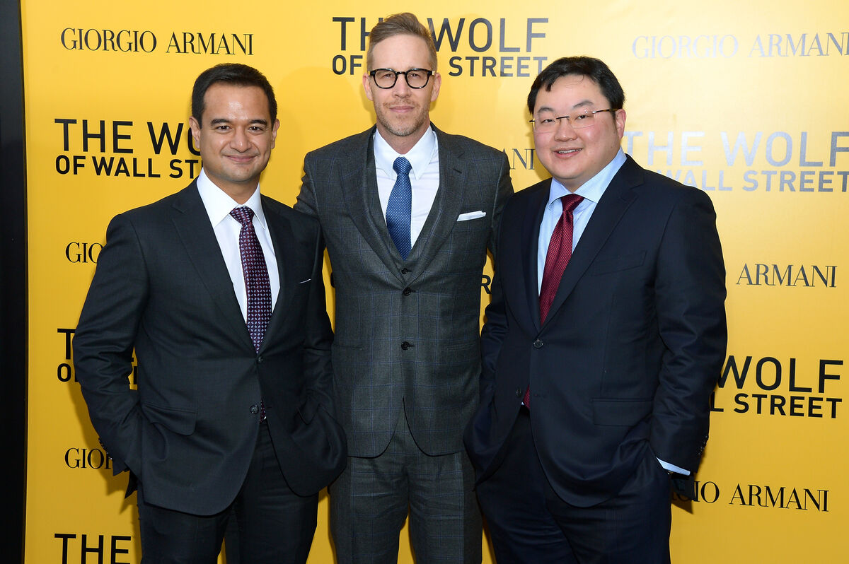 Producers Riza Aziz, Joey McFarland, and Jho Low attend The Wolf of Wall Street premiere in New York City, 2013. Photo by Michael Loccisano/Getty Images.