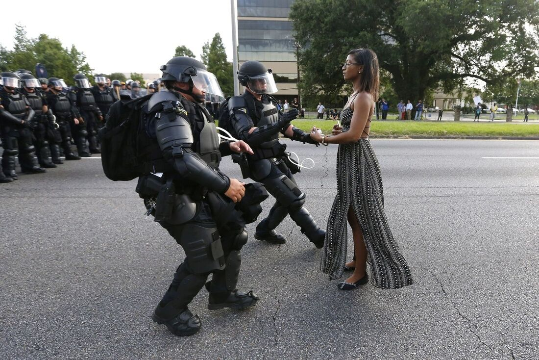 A demonstrator protesting the shooting death of Alton Sterling is detained by law enforcement near the headquarters of the Baton Rouge Police Department in Baton Rouge, Louisiana, U.S. July 9, 2016. REUTERS/Jonathan Bachman/File Photo