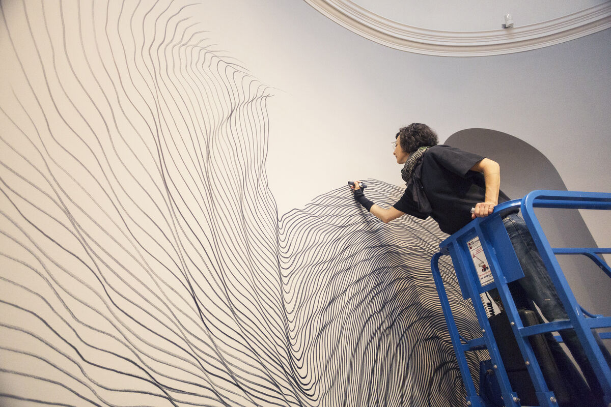 linn meyers working on Let's Get Lost,  at the Bowdoin College Museum of Art, Brunswick, Maine, 2018. Photo by Dennis Griggs, Tannery Hill Studio, Maine. Courtesy of the Bowdoin College Museum of Art.
