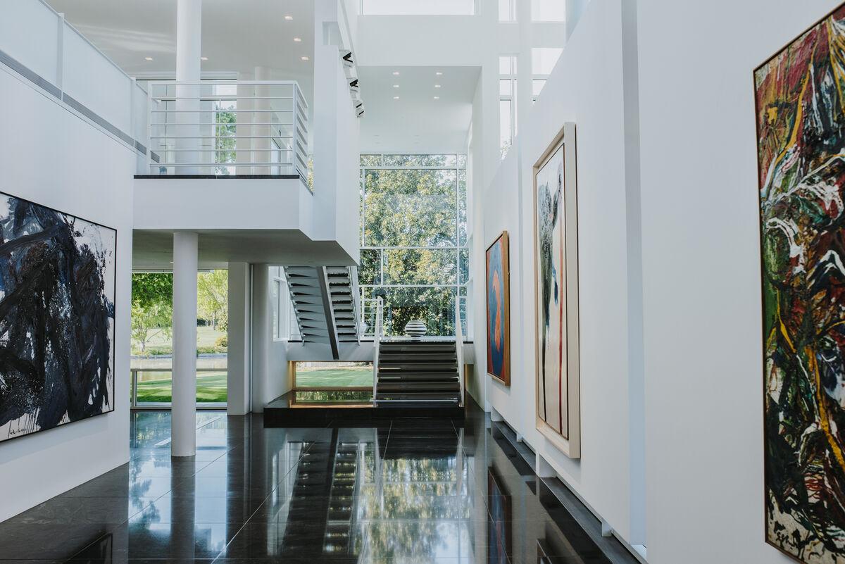 Works by Kazuo Shiraga, Kazunori Hamana, Sadamasa Motonaga, and Shozo Shimamoto are featured in the Rachofsky home. Photo by Valerie Chiang for Artsy.