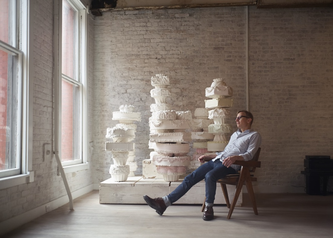 Portrait of Will Cotton in front of Against Nature (2012), in his Tribeca studio by Alex John Beck for Artsy.