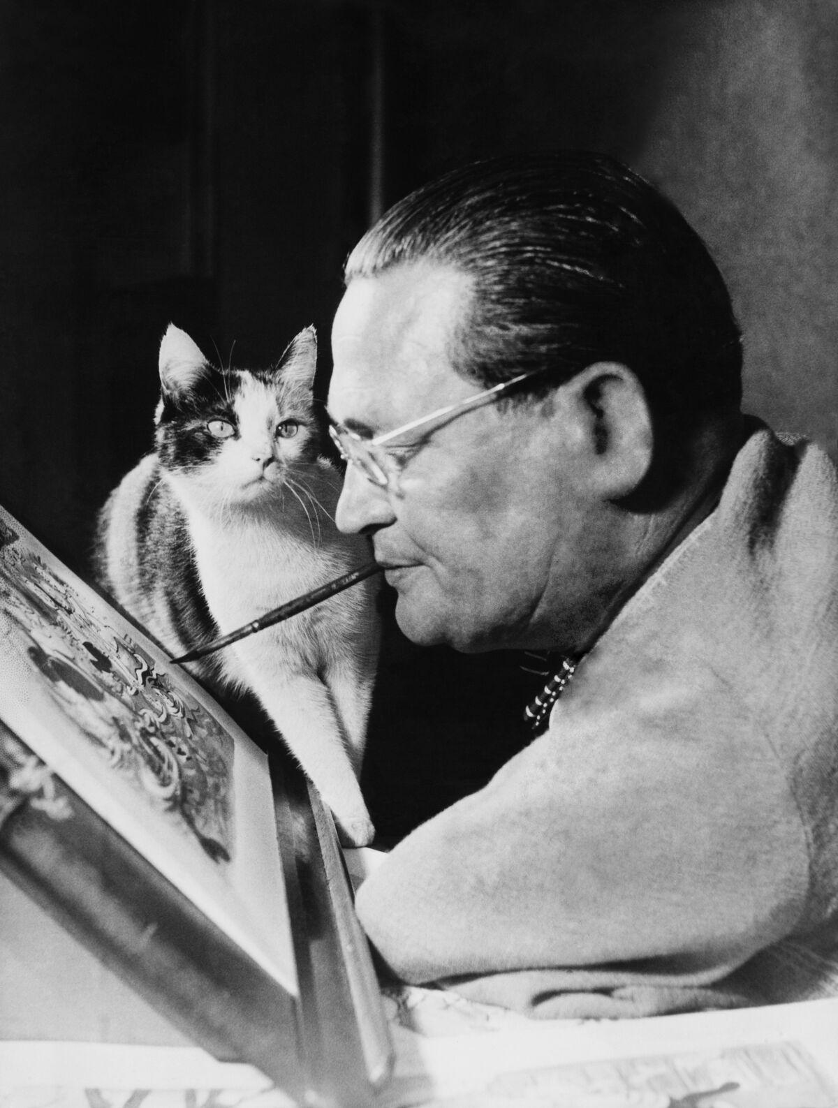 Portrait of Carl Fischer  with cat. Photo by Keystone-France/Gamma-Keystone via Getty Images.