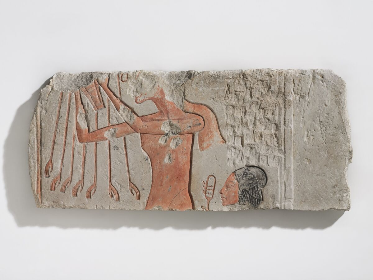 Akhenaten and His Daughter Offering to the Aten,                    ca. 1353–36 B.C.E. Courtesy of the Brooklyn Museum.