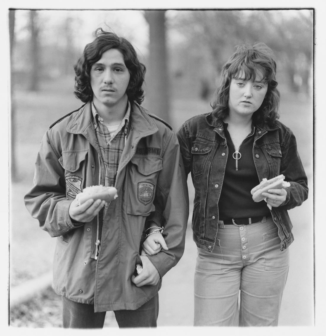 Diane Arbus,A young man and his girlfriend with hot dogs in the park, N.Y.C., 1971.© The Estate of Diane Arbus