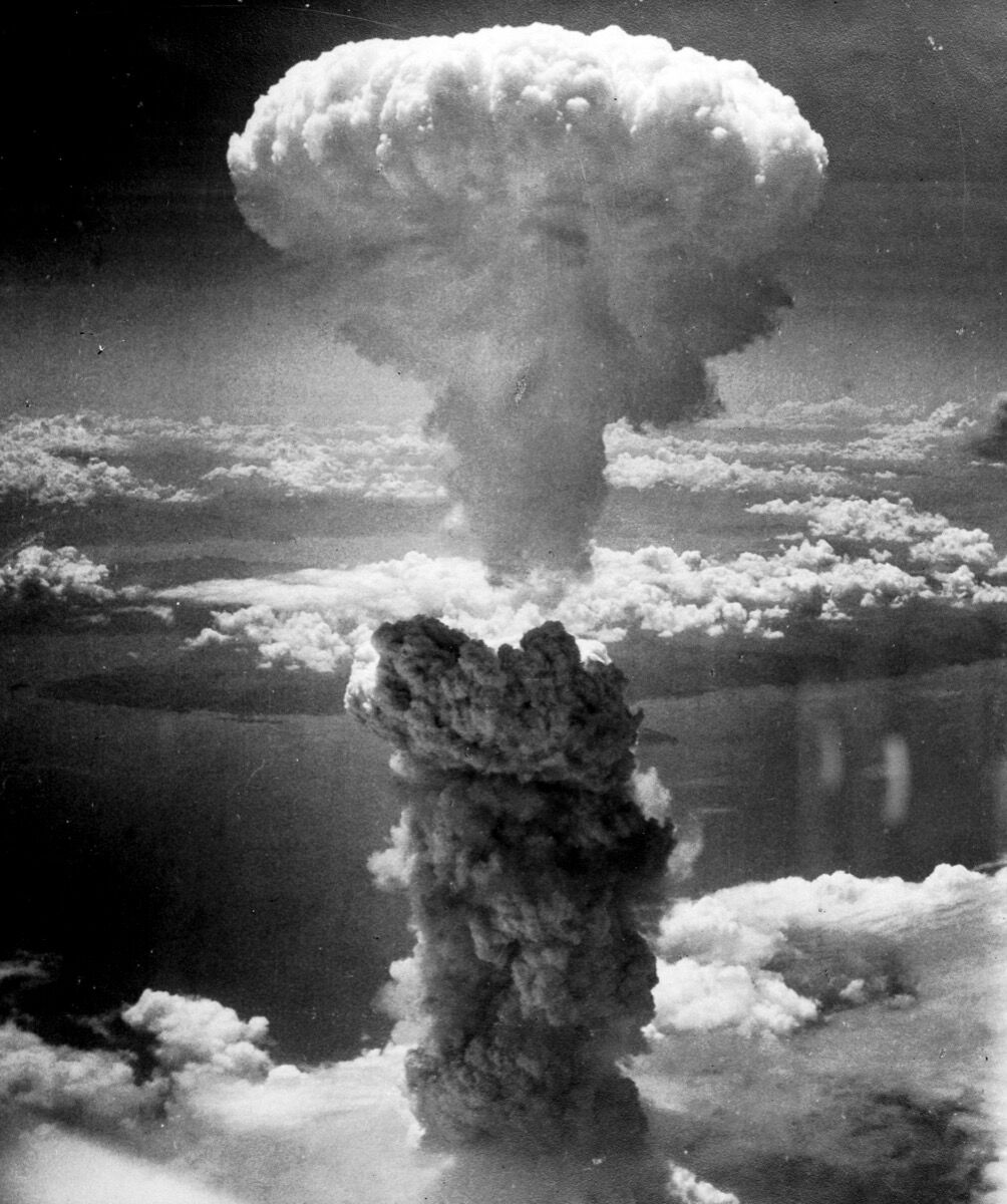 Atomic Cloud Rises Over Nagasaki, Japan. Photo by Lieutenant Charles Levy, 1945, via Wikimedia Commons.