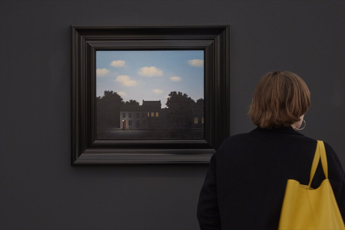 Installation view of René Magritte's L'empire des Lumières, 1949, at Dickinson's booth at Frieze Masters, 2016. Photo by Benjamin Westoby for Artsy.