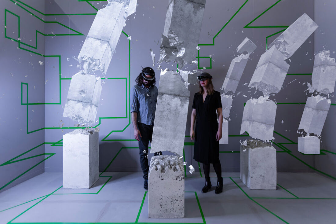"Artist duo Studio Drift inside ""Concrete Storm,"" their mixed reality installation at Artsy's booth at The Armory Show 2017. Photo by Silvia Ros for Artsy."