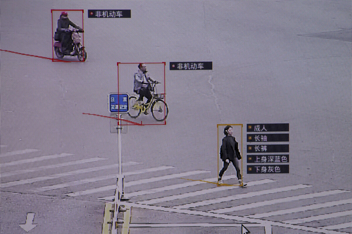 A demonstration of SenseTime surveillance software identifying details about people and vehicles. Image by REUTERS/Thomas Peter.
