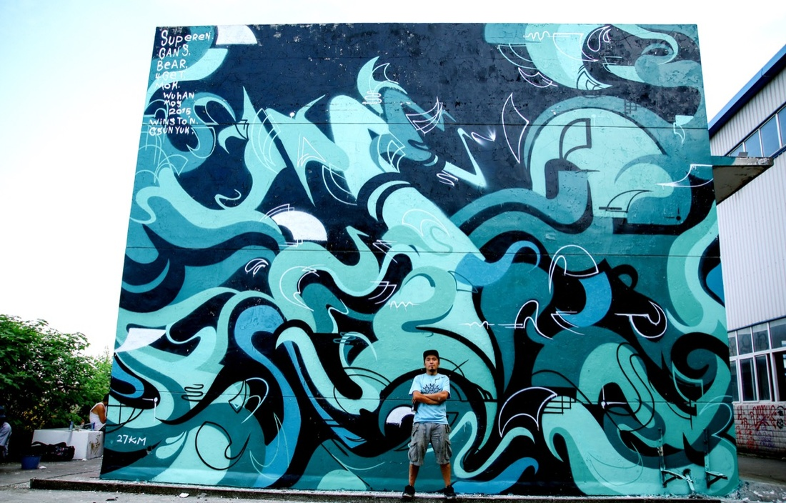 4Get and his mural in Hong Kong. Photo by Superen. Courtesy of 4Get.