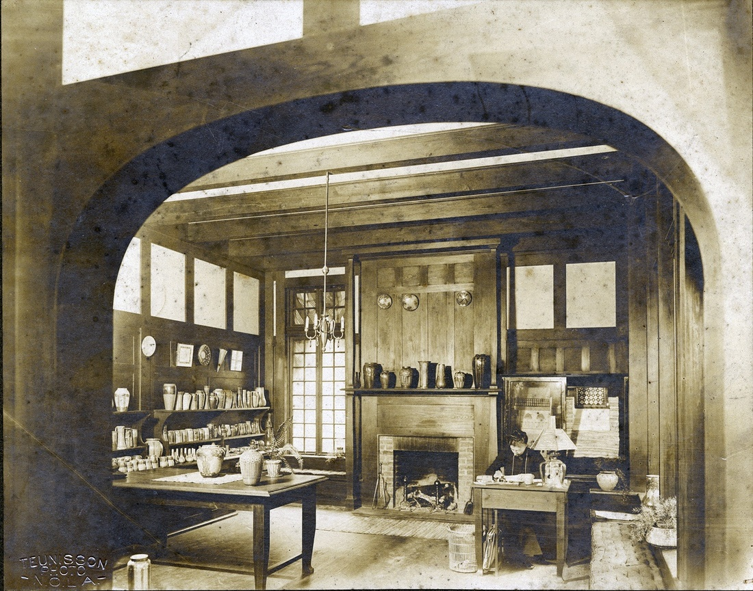 Desiree Roman seated in salesroom of Newcomb Pottery in Crafts building on Newcomb Camp Street campus, c. 1905-1910. Courtesy of the Newcomb Archives - Photo Archives Collection.