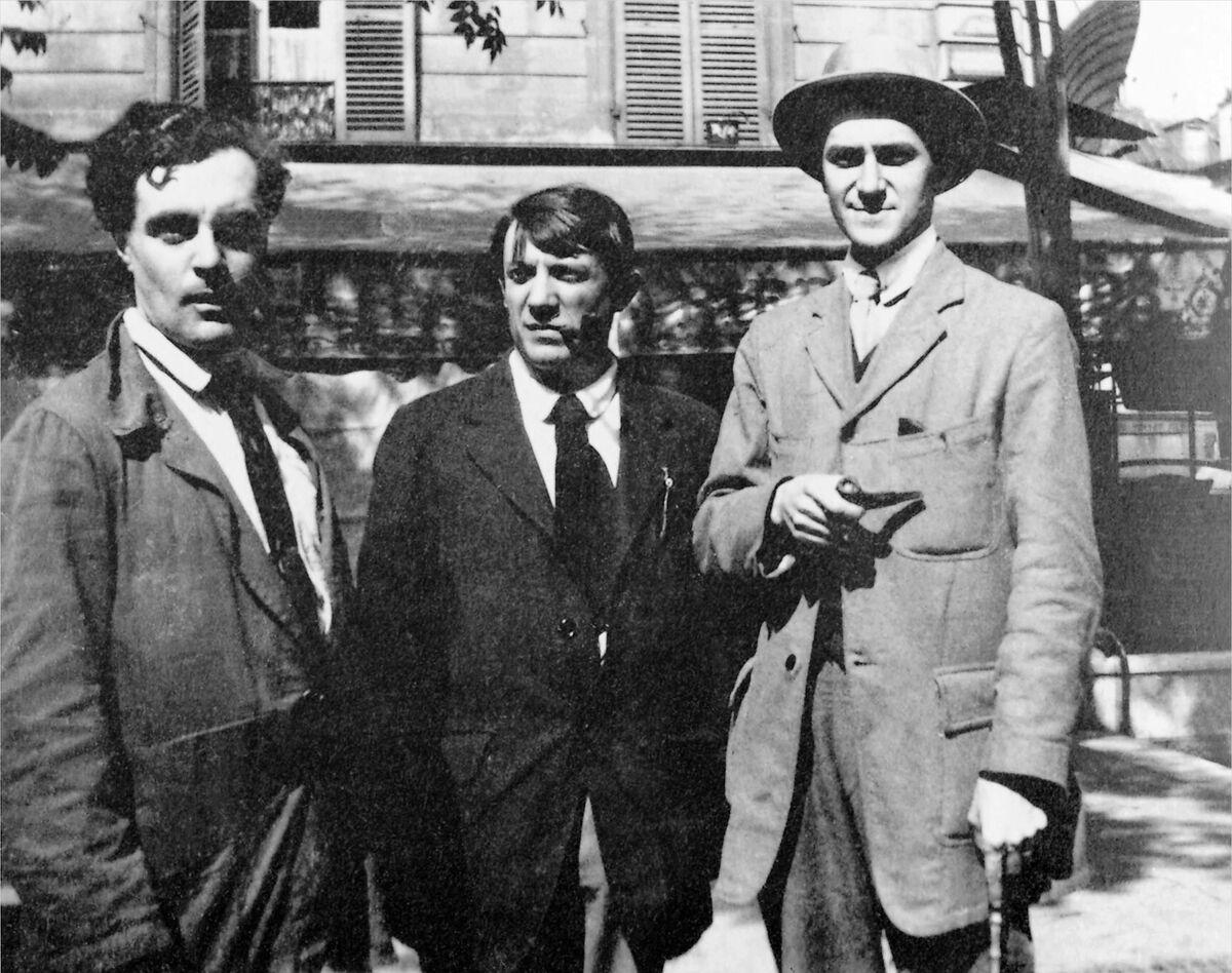 Modigliani, Picasso and André Salmon in front the Café de la Rotonde, Paris. Image taken by Jean Cocteau in Montparnasse, Paris in 1916, via Wikimedia Commons.