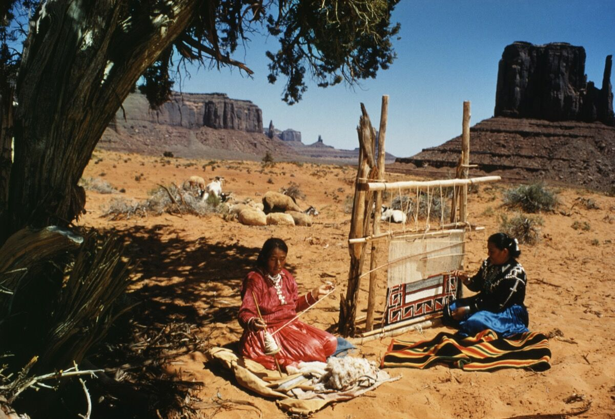 Navajo women weaving a blanket at Monument Valley, Arizona, USA. Photo by Universal History Archive/UIG via Getty Images.