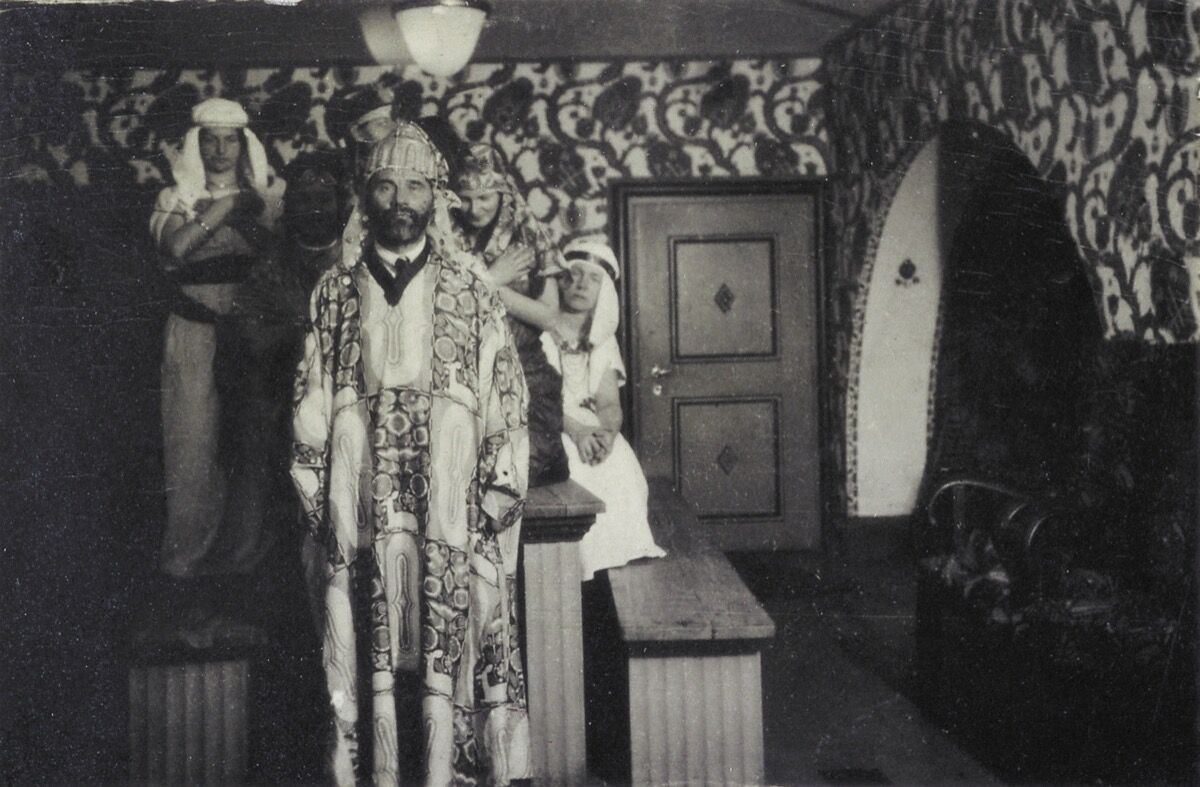 Gustav Klimt as an attendant of an party in the Primavesi-house, with a house-coat designed by Carl Otto Czeschka. Photo by Imagno/Getty Images.