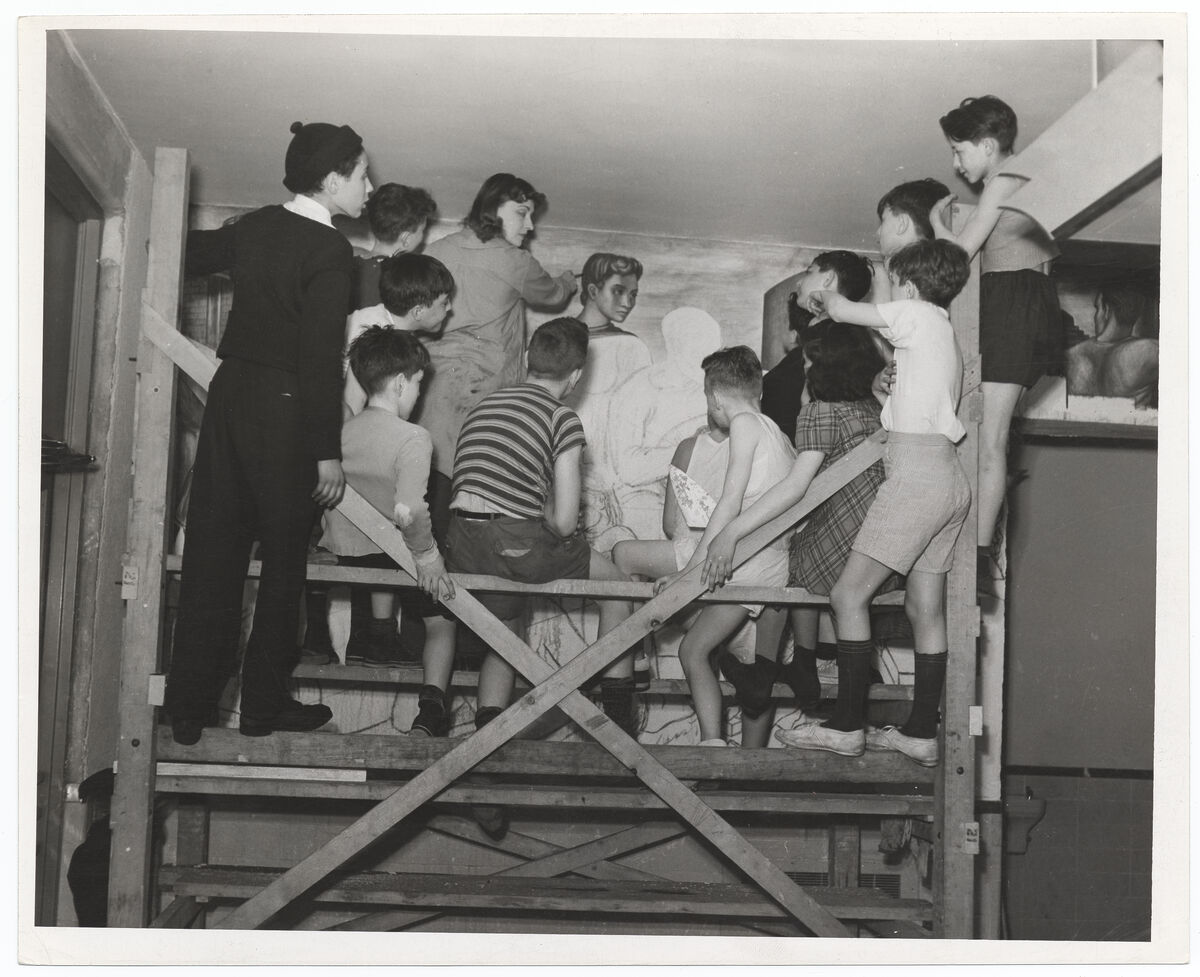 Shalat, Marion Greenwood with a group of children on scaffolding, 1940. Photographed for the WPA. Image via Wikimedia Commons.