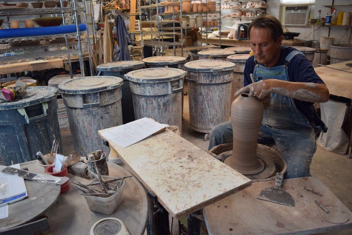 David Fernandez working at Seagrove Stoneware Inn & Pottery. Photo by Richard Shoenberger.