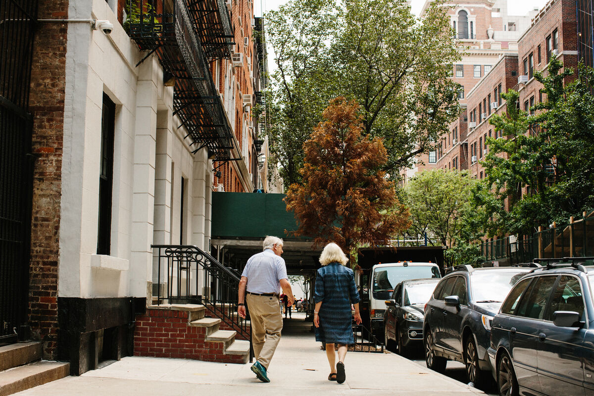 Portrait of Peter and Sally Saul walking on the Upper East Side by Stephanie Noritz for Artsy.