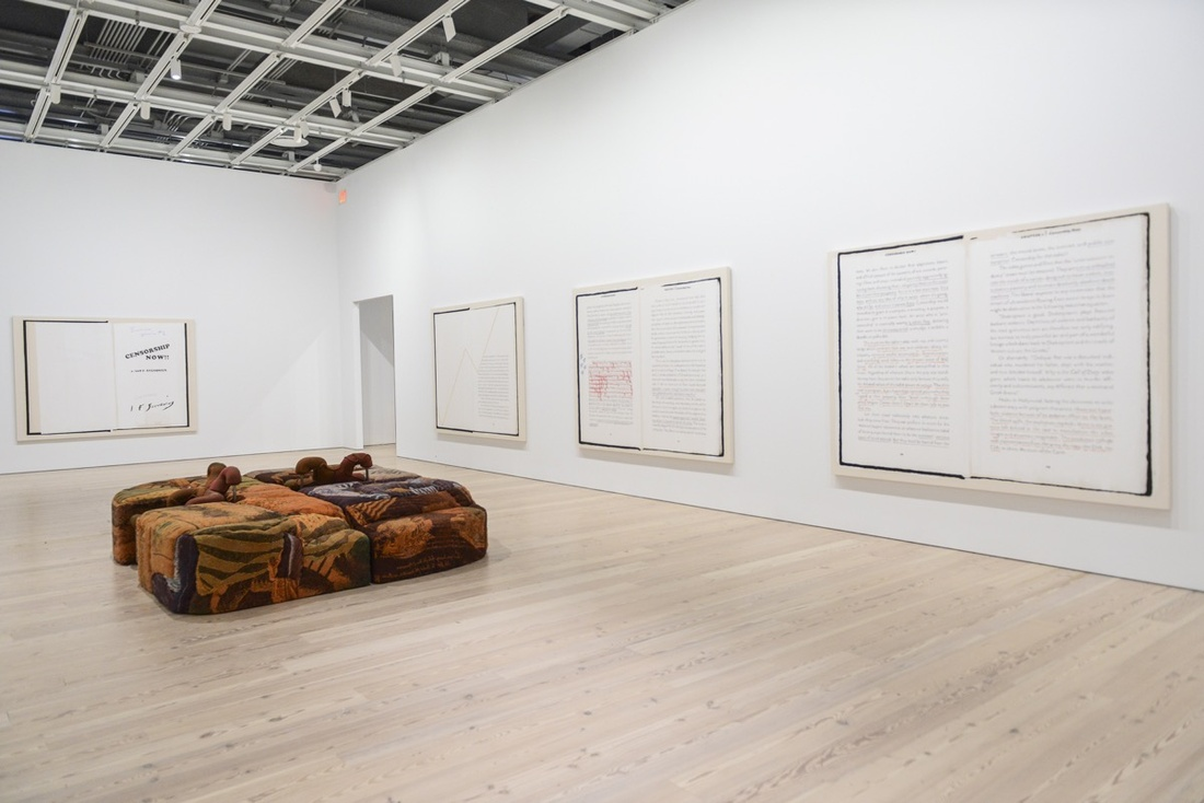 """Installation view of Jessi Reaves, Ottoman with Parked Chairs, 2017, and Frances Stark, Ian F. Svenonius's """"Censorship Now"""" for the 2017 Whitney Biennial, 2017, at the 2017 Whitney Biennial. Photograph by Matthew Carasella, courtesy of the Whitney Museum of American Art."""