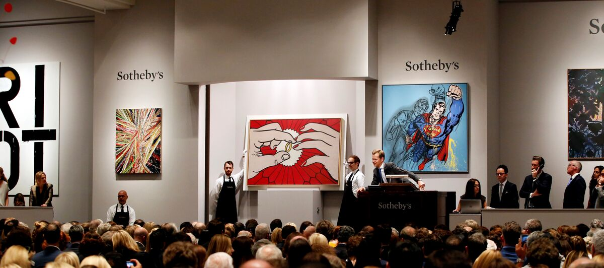 Sotheby's New York Contemporary Art Evening Auction, 12 May 2015. Works shown: Christopher Wool, Untitled (Riot), 1990; Mark Grotjahn, Untitled (Into and Behind the Green Eyes of the Tiger Monkey Face 43.18), 2011; Roy Lichtenstein, The Ring (Engagement); Andy Warhol, Superman, 1981. Photo courtesy of Sotheby's.