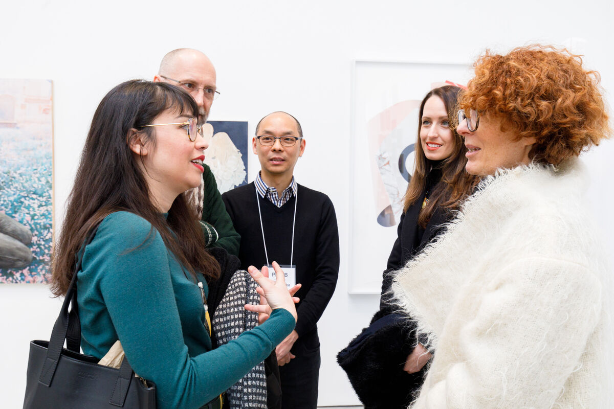 "VOLTA Artistic Director, Amanda Coulson (far right), catches up with alumni Rachel Mijares Fick (left) and Beca Laliberte (near right) and Plan B gallerists Robert Walden and Henry Chung, co-owners of Robert Henry Contemporary, Brooklyn, at ""Plan B,"" 2019. Photo by David Willems Photography. Courtesy of Plan B."