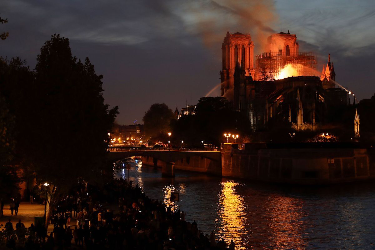 Notre Dame Cathedral engulfed in flames in Paris as darkness set on April 15, 2019. Photo by Thomas Samson / AFP.