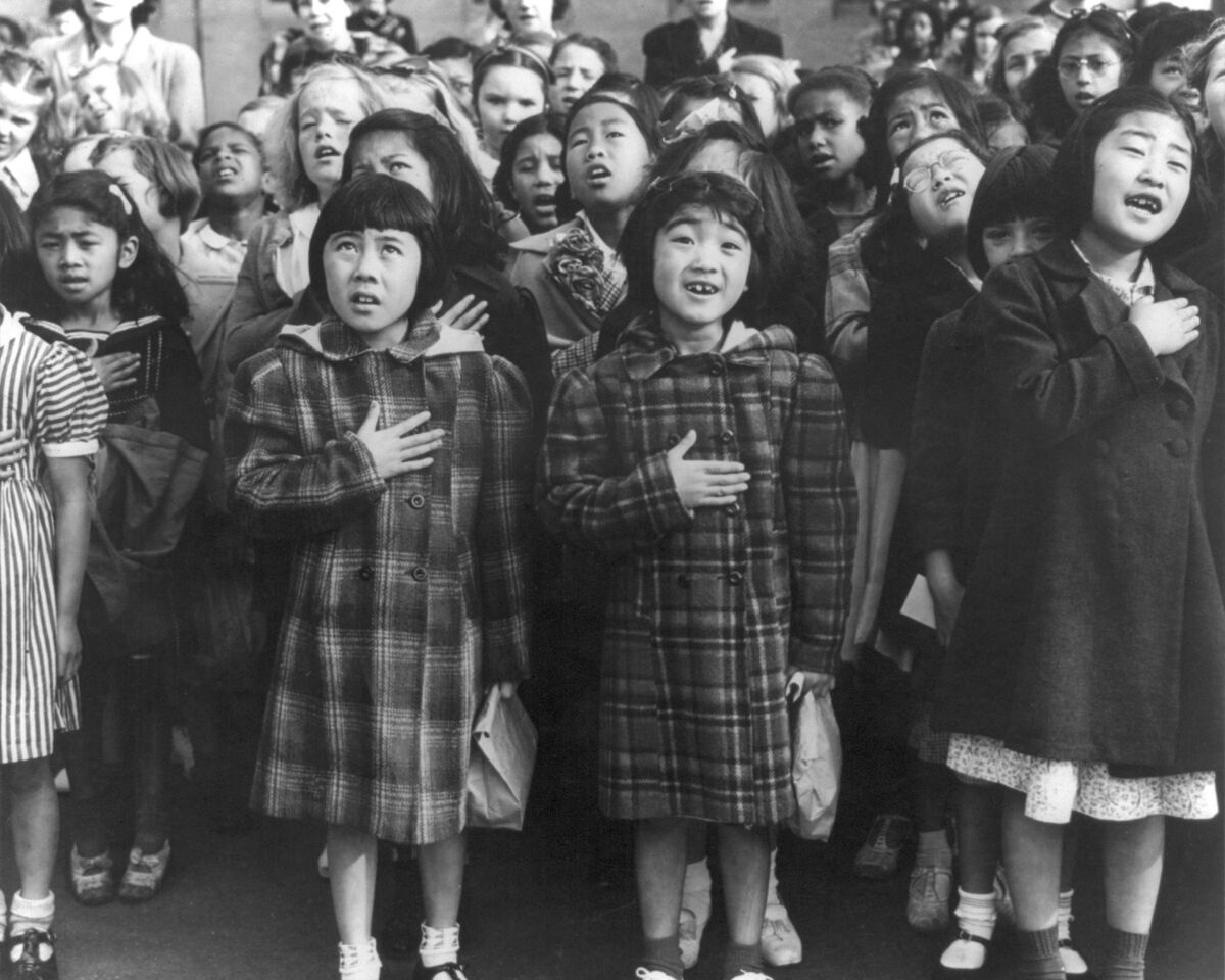 Dorothea Lange, San Francisco, Calif., April 1942 - Children of the Weill public school, from the so-called international settlement, shown in a flag pledge ceremony. Some of them are evacuees of Japanese ancestry who will be housed in War relocation authority centers for the duration, 1942. Courtesy of the Library of Congress.