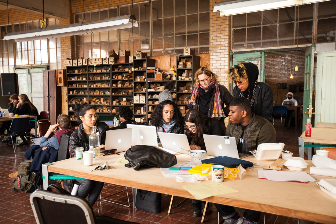 A group of fellows prepare their presentation at Ideas City Detroit. Photo by Marta Xochilt Perez for Artsy.