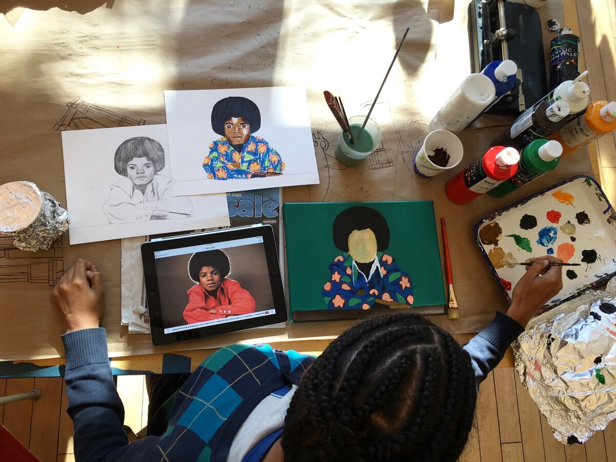 Myasia Dowdell working at LAND Gallery. Courtesy of LAND Gallery.