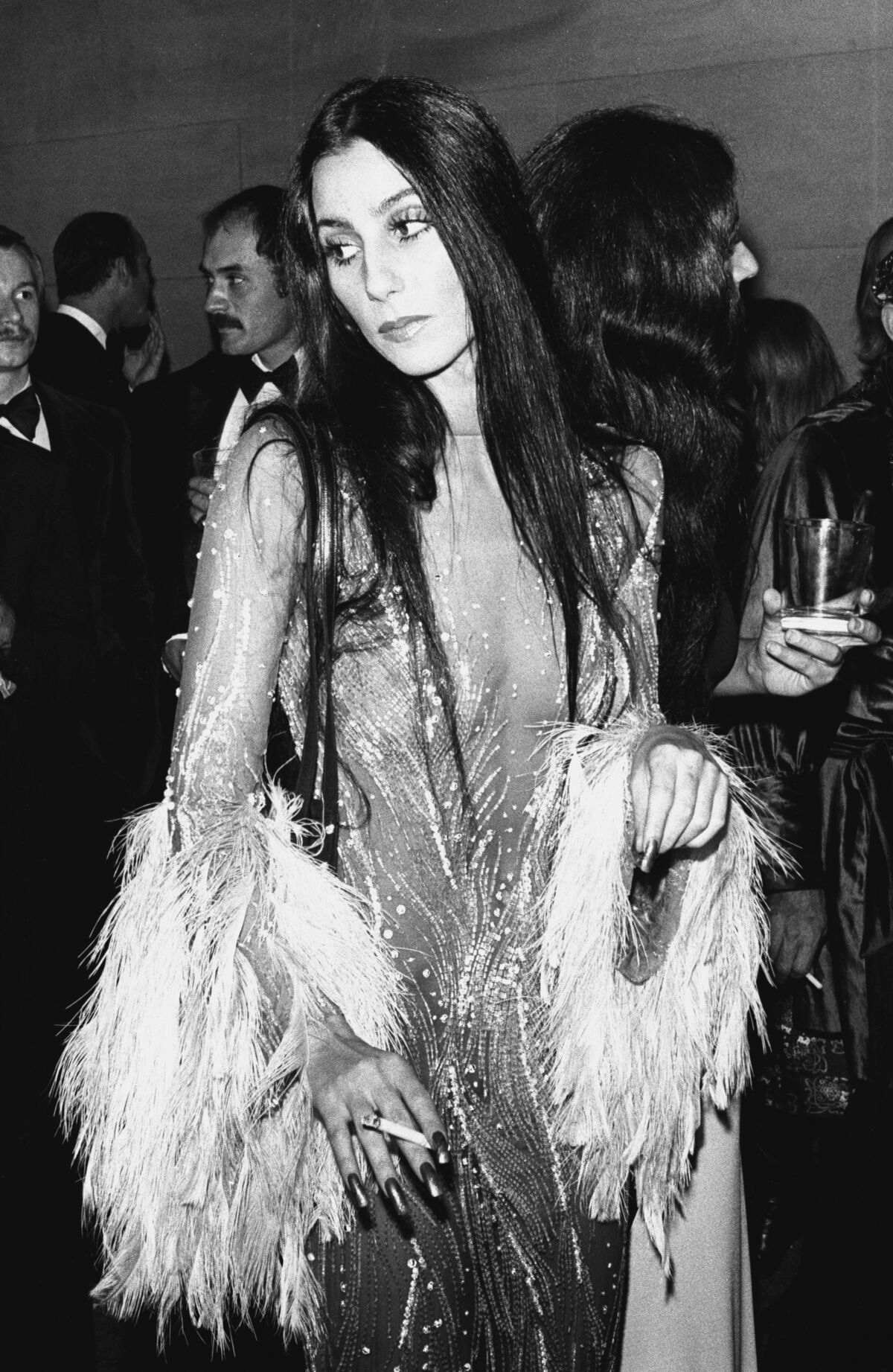 """Cher at the """"Romantic and Glamorous Hollywood Design"""" Costume Institute Benefit Gala at the Metropolitan Museum of Art, New York, 1974. Photo by Ron Galella/WireImage."""