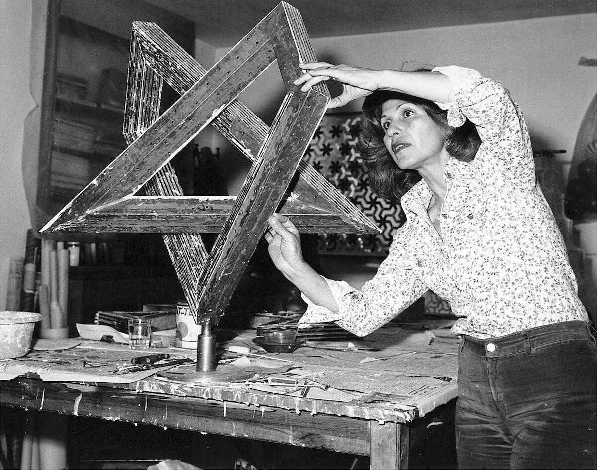Monir Farmanfarmaian working in her studio in Tehran, 1975. Photo courtesy the artist's family and Haines Gallery.