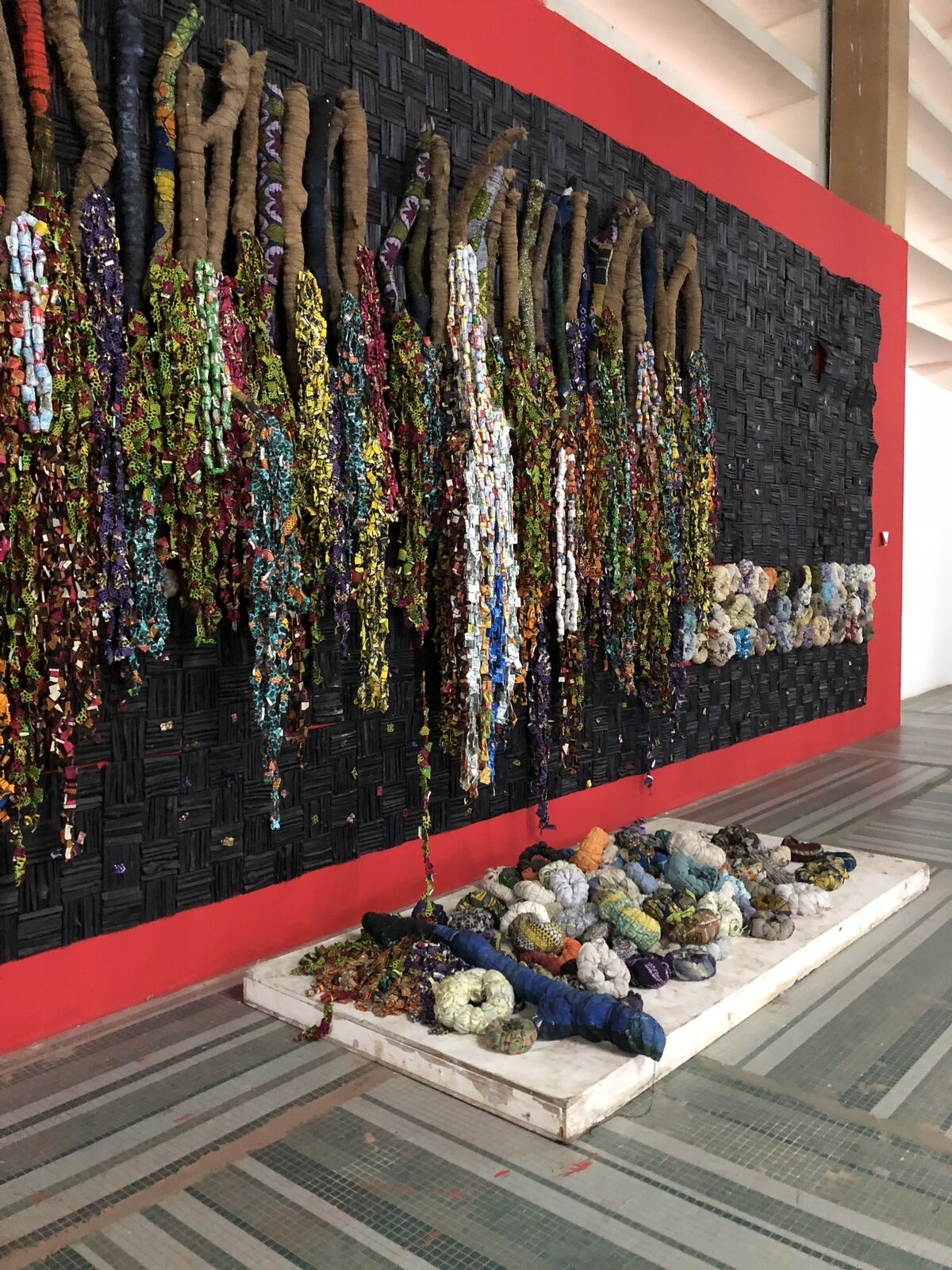 Installation view of work by Olanrewaju Tejuoso (Olan), Oldies and Goodies, 2017-18, at Dak'Art: African Contemporary Art Biennale, Dakar, 2018. Photo © Oumy Diaw.
