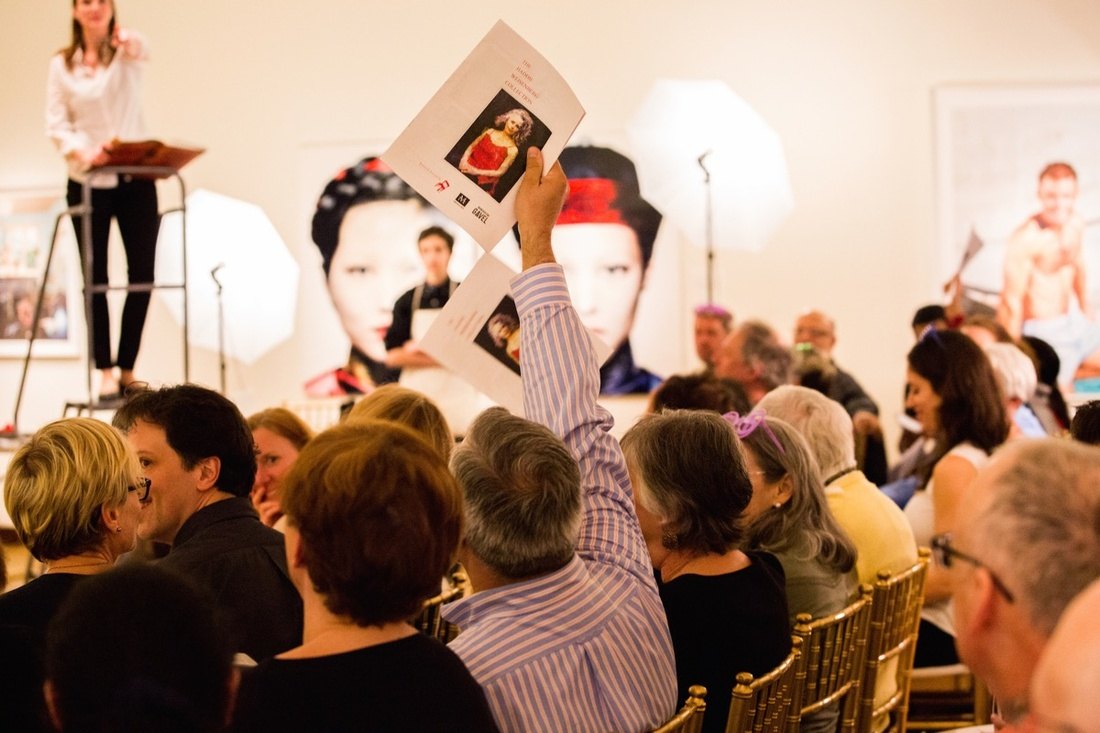 """Audience bidding at a performance of """"Beneath the Gavel"""" held at the New Britain Museum of American Art in Connecticut. Photo by Will Gangi."""