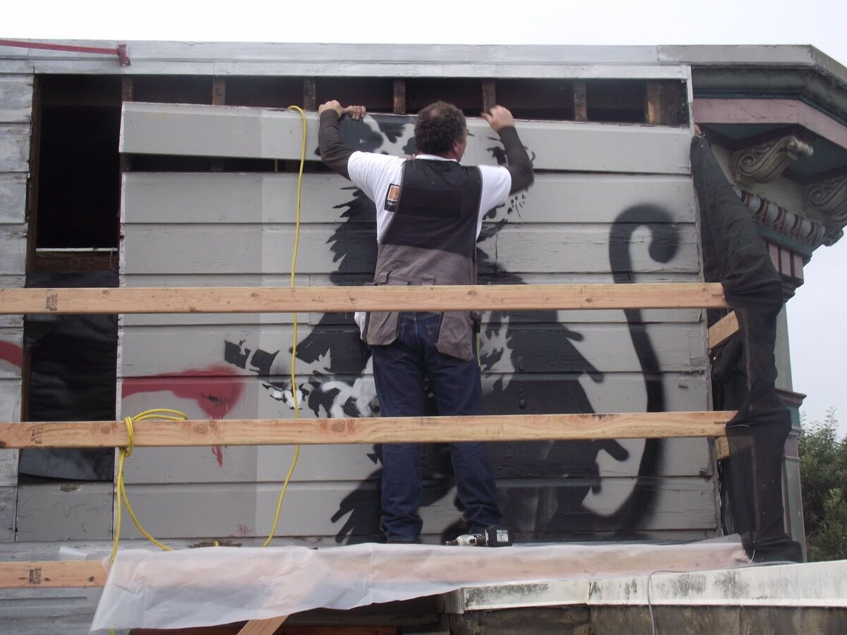 "Removal of Banksy's ""Haight Street Rat."" Image courtesy of Candy Factory Films and Parade Deck Films."
