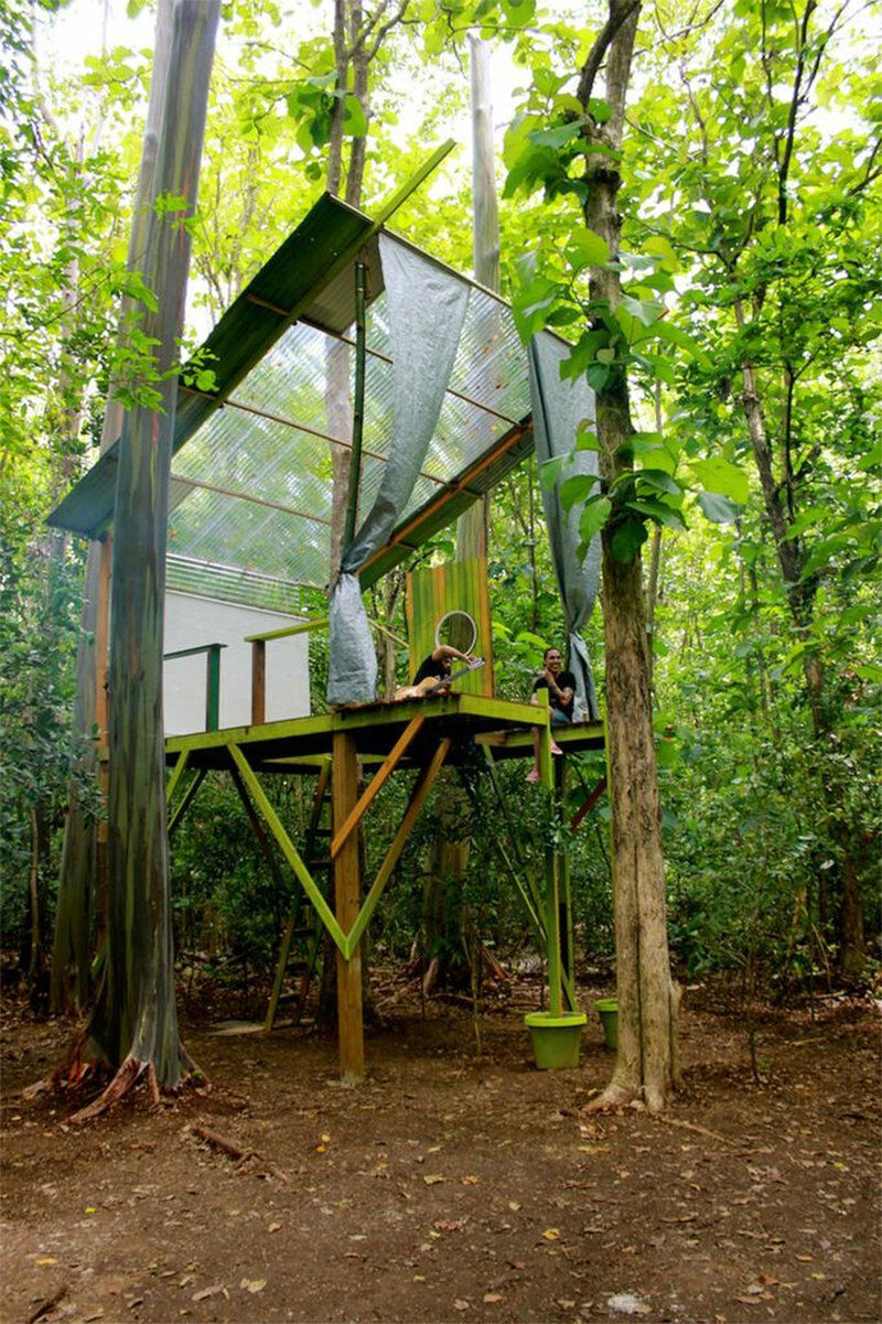 "Radamés ""Juni"" Figueroa, Tree house—Casa Club, 2013. Wood, plastic tent, bamboo, zinc iron, corrugate plastic, glass window,  299 3/16 × 192 15/16 × 192 15/16 in. (760 × 490 × 490 cm) Collection of the artist. © Radamés ""Juni"" Figueroa. Photograph by Radamés ""Juni"" Figueroa"