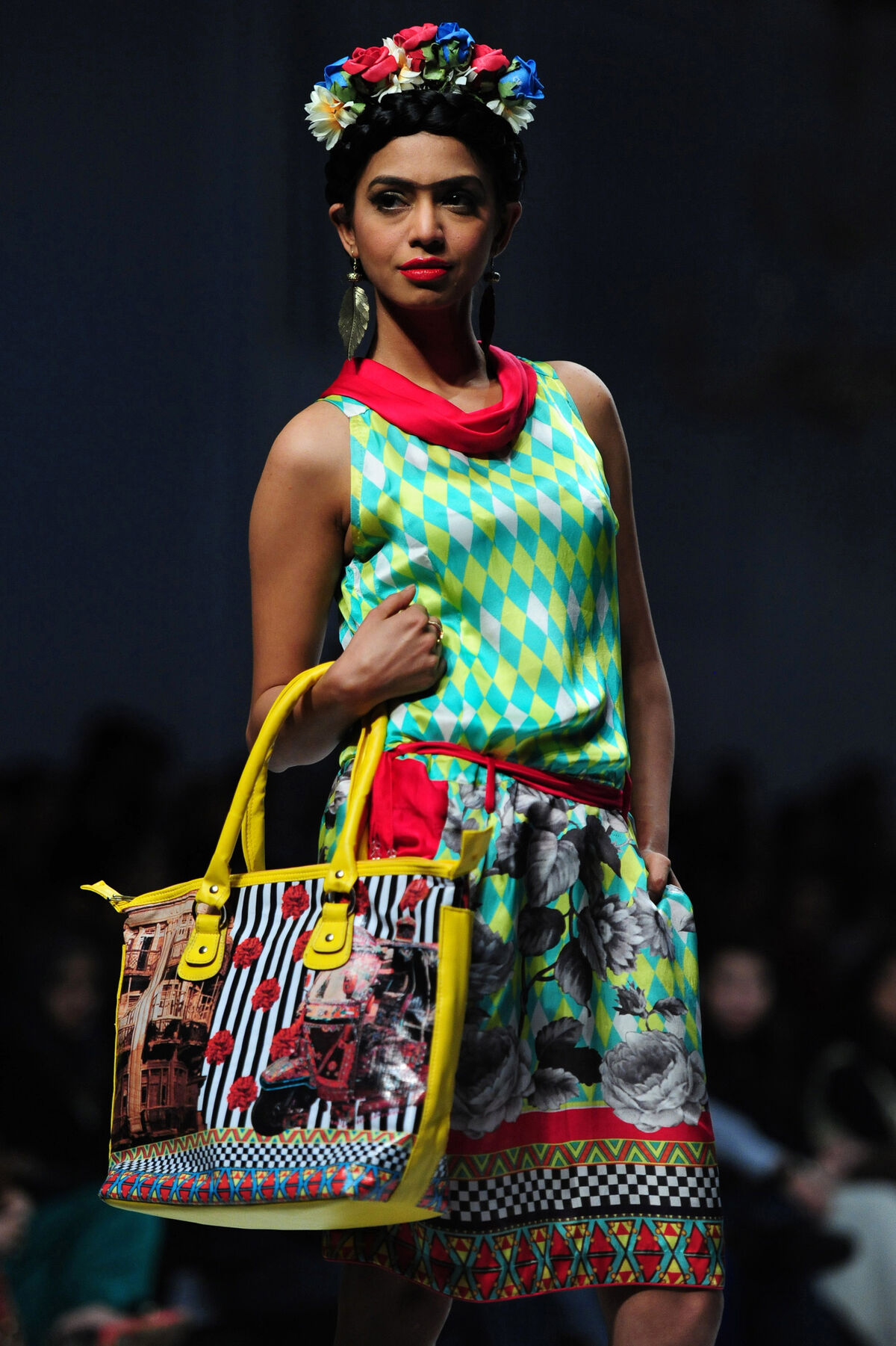 A Pakistani model presents a creation by Deepak Perwani on the second day of Fashion Pakistan Week, Karachi, 2013. Photo by Asif Hassan/AFP/Getty Images.