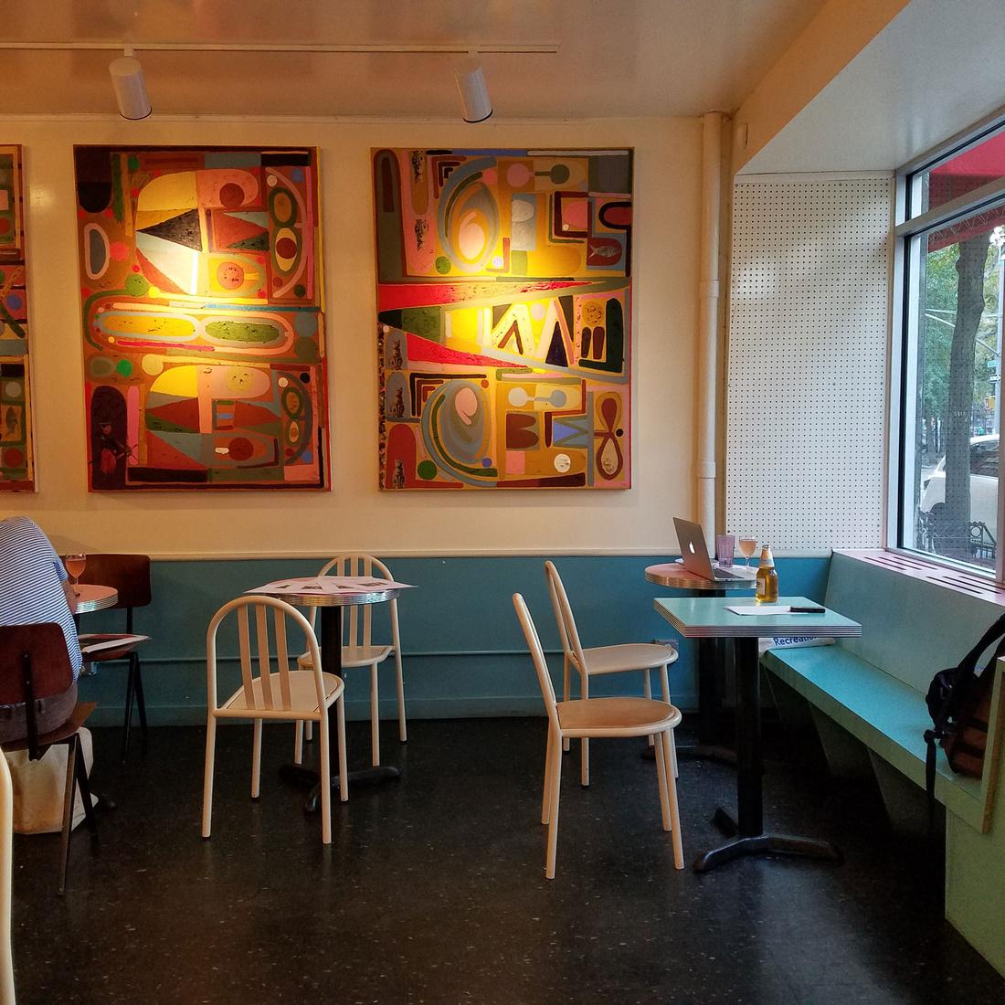 Installation shot of Eddy's work in Café Henrie.