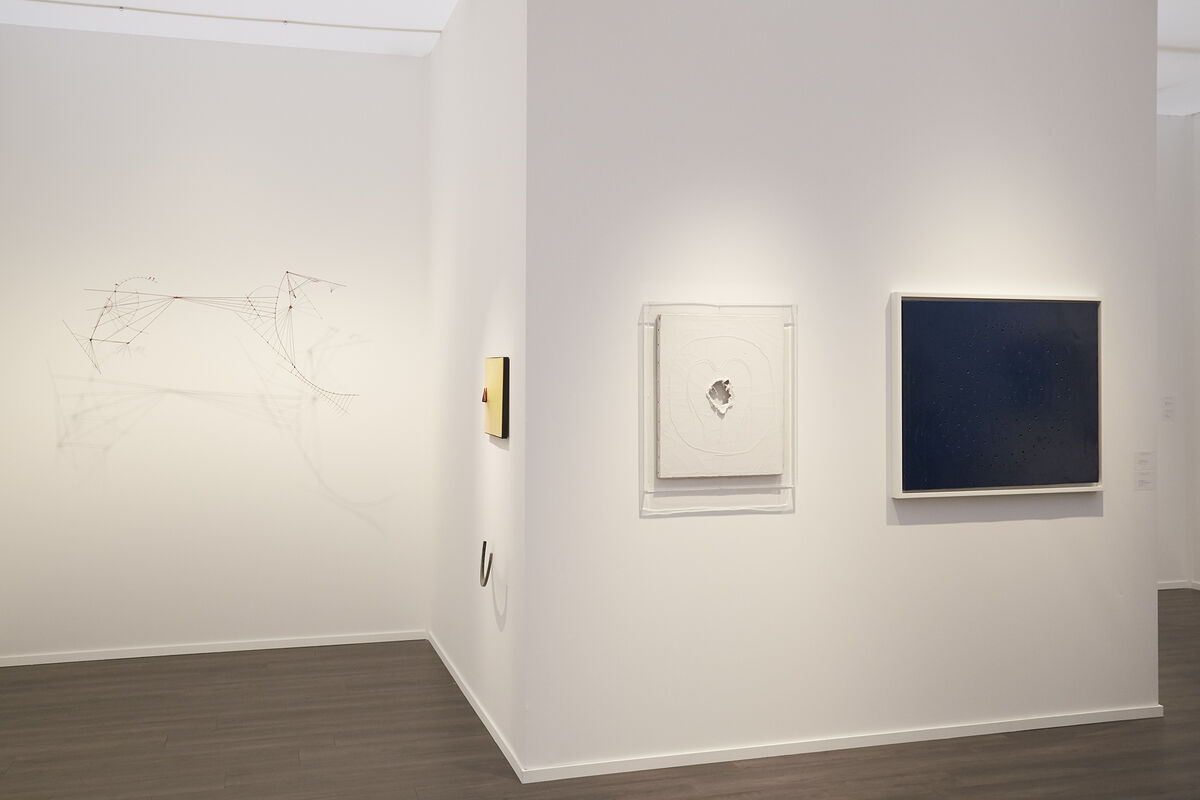Lucio Fontana, Concetto Spaziale, and other works on view at Luxembourg & Dayan's booth at Frieze Masters, 2015. Photo by Benjamin Westoby for Artsy.