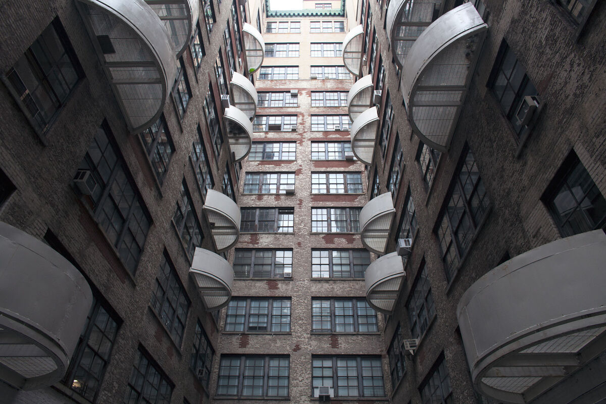 """It's like a hive in here,"" Elizabeth Gregory-Gruen said of Westbeth, a theme that recurs in the radiating fire escapes in the building's interior courtyard. They don't lead to the ground—in case of fire, residents are meant to crawl to a neighbor's incombustible, concrete apartment. Photo by Frankie Alduino."