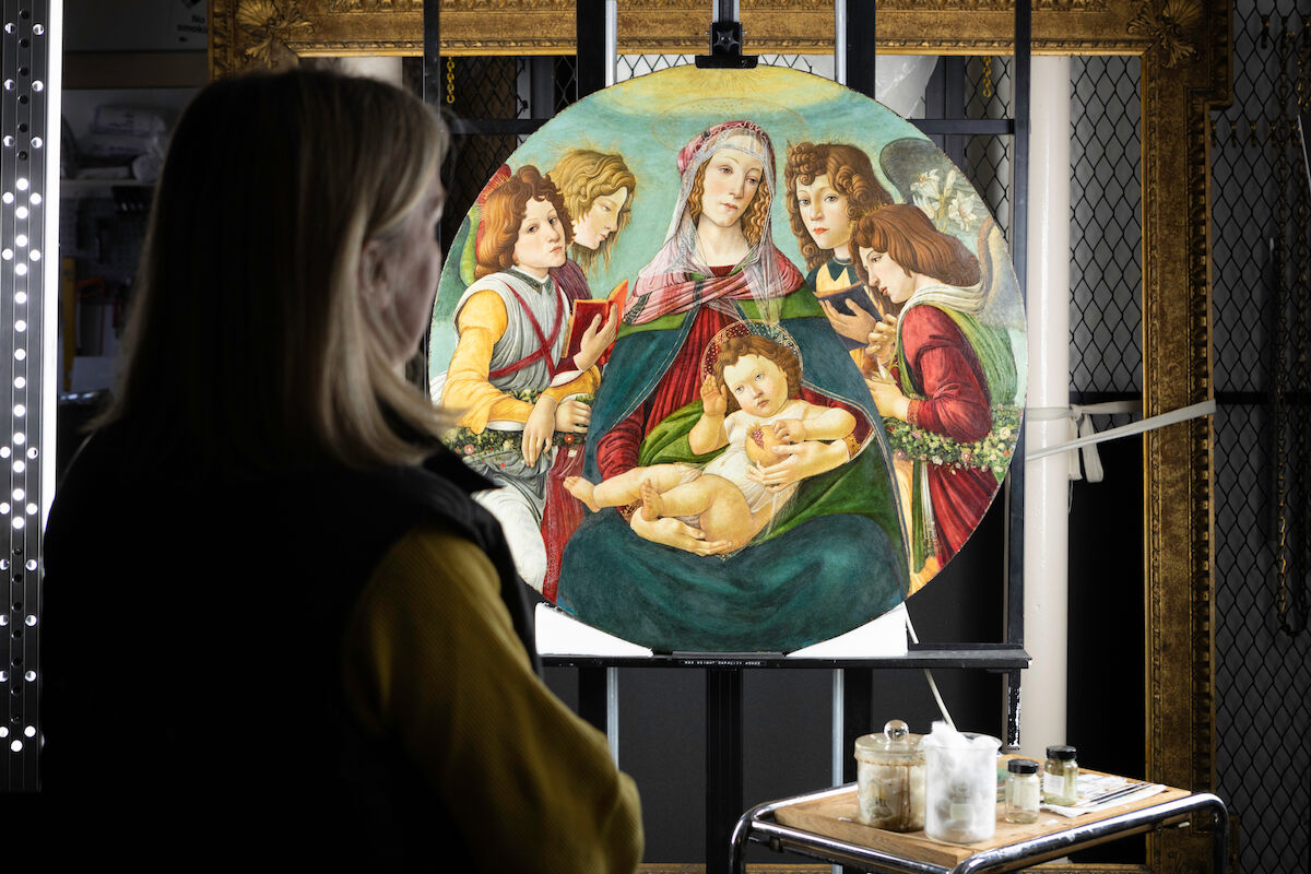 Rachel Turnbull, Senior Collections Conservator at English Heritage, with Madonna of the Pomegranate (ca. 1487). Courtesy English Heritage.