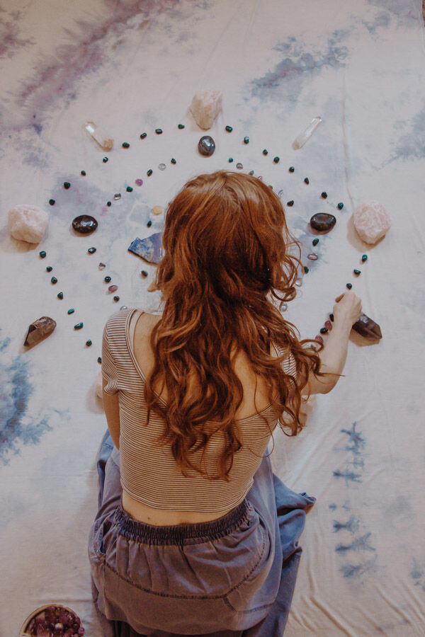 Sadie Kadlec of Maha Rose Healing Center, Brooklyn building a crystal grid. Photo by Grayson Gilbert.