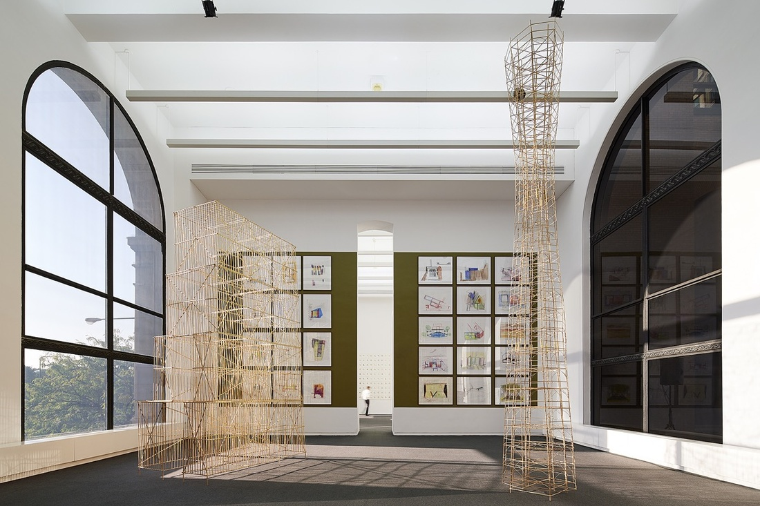Installation view of Bak Gordon Arquitectos, Desenhos de Trabalho (Working Drawings) with Studio Mumbai's Prima Materia, 2017. Courtesy of Chicago Architecture Biennial, Kendall McCaugherty © Hall Merrick Photographers.