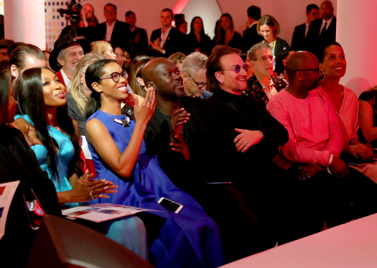 Naomi Campbell, David Adjaye, Bono, Theaster Gates, and others in the front row at Sotheby's 2018 (RED) benefit auction. Photo by Cindy Ord/Getty Images for (RED).