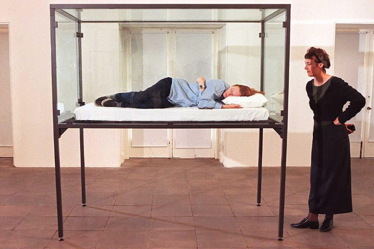 Tilda Swinton sleeps in a glass box as part of an exhibition  at the Serpentine Gallery 1995  in London. Photo by Andrew Winning/AFP/Getty Images.