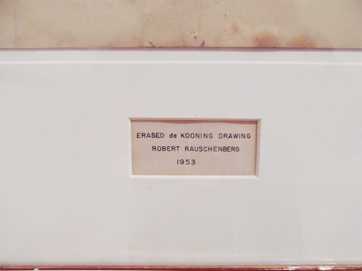 Detail of Robert Rauschenberg's Erased de Kooning Drawing, 1953, showing the inscription made by Jasper Johns. Courtesy of San Francisco Museum of Modern Art.