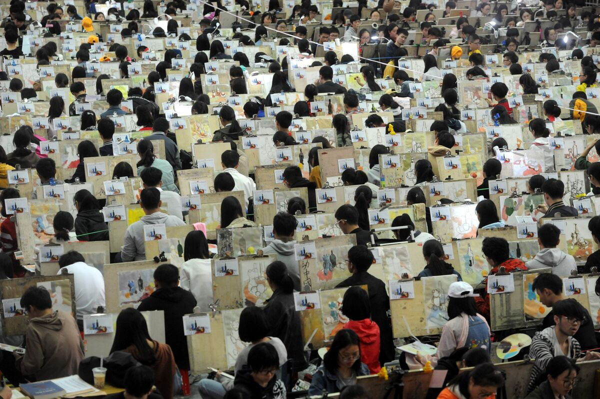 Nearly 7,000 students take part in the college entrance exam for art at Shungeng International Convention and Exhibition Center on February 16, 2016 in Jinan, China. Photo by VCG/VCG via Getty Images.