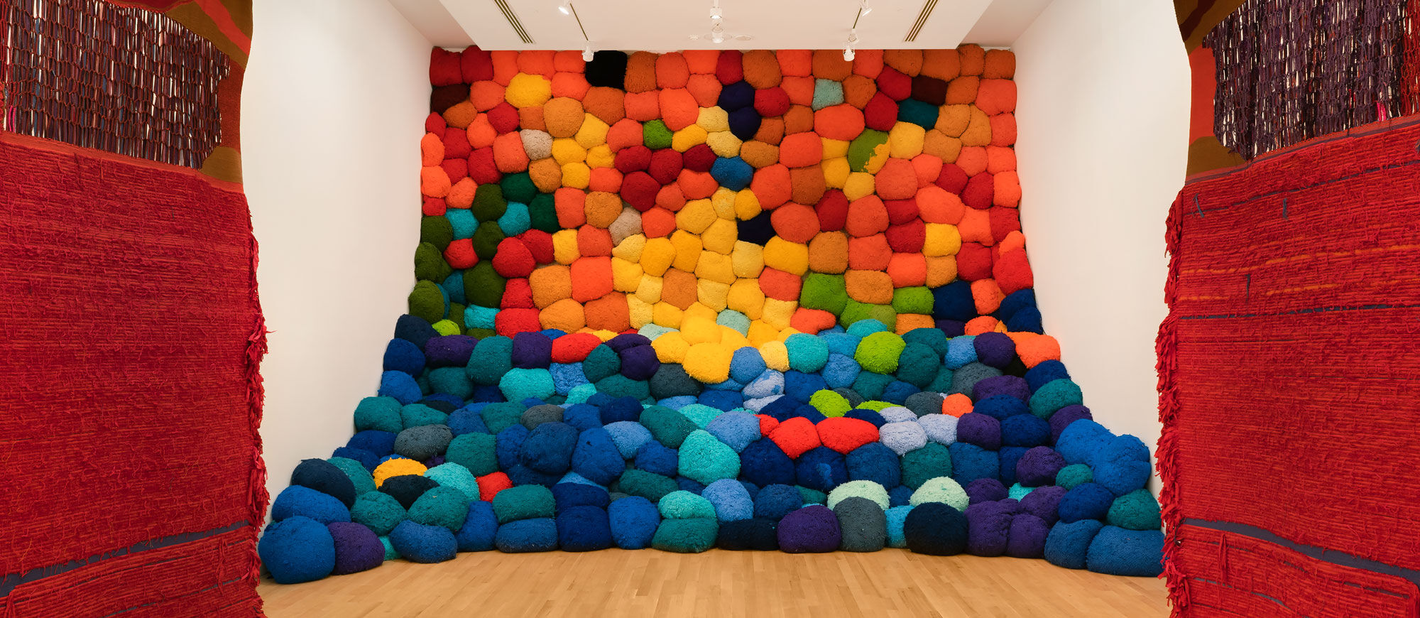Installation view of Sheila Hicks, Escalade Beyond Chromatic Lands, 2016–17, at The Bass, 2019. Photo by Zachary Balber. Courtesy of The Bass, Miami Beach.